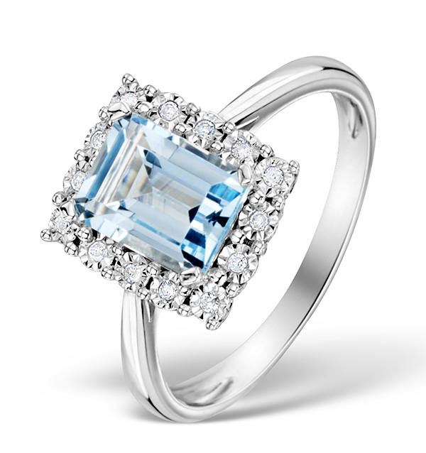 BLUE TOPAZ 8 X 6MM AND DIAMOND 9K WHITE GOLD RING