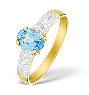 9K Gold Diamond and Blue Topaz Solitaire Style Ring - E4080