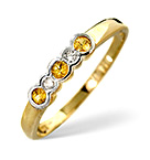 YELLOW SAPPHIRE AND DIAMOND RING IN A RUBOVER SETTINGS