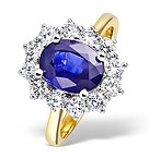 Tanzanite 9 x 7mm And Diamond 18K Gold Ring